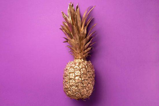 creative-layout-gold-pineapple-on-violet-backgroun-NJ6LXD5-scaled.jpg